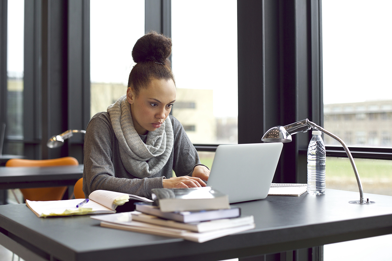 Focused student studying online for a Bachelor of Professional Studies degree