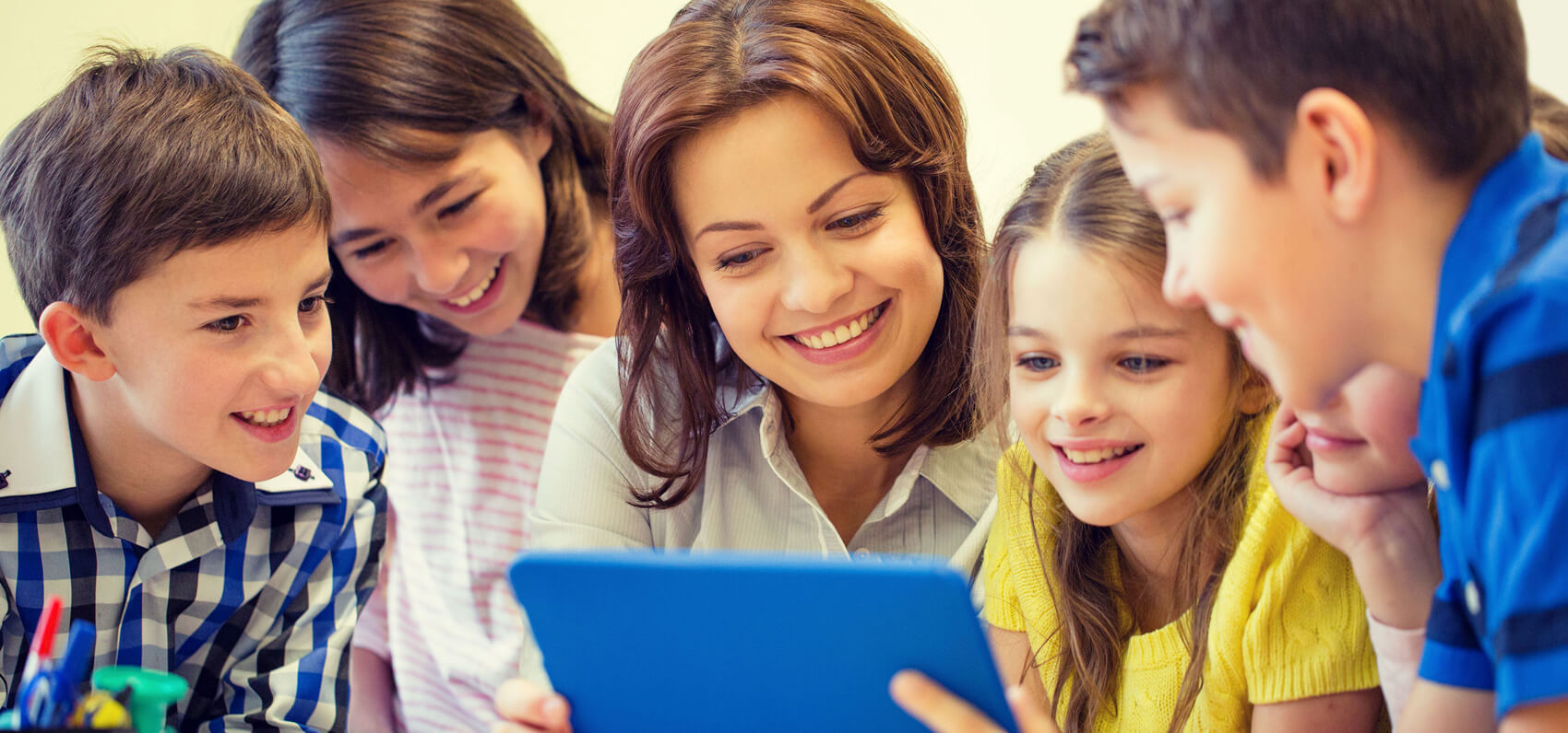 Master of Educational Technology teaching children with a mobile device